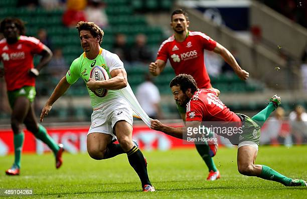 Kwagga Smith of South Africa is tackled by Francisco Almeida of Portugal during the Marriott London Sevens match between South Africa and Portugal at...