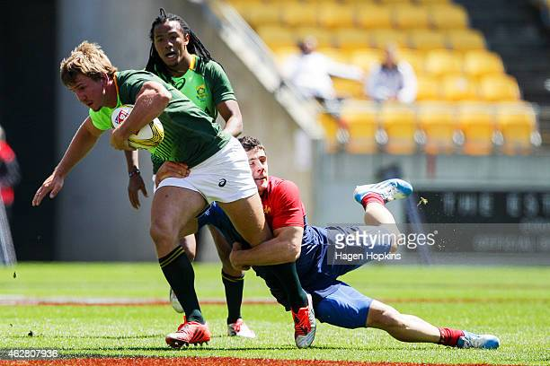 Kwagga Smith of South Africa is tackled during the match between France and South Africa in the 2015 Wellington Sevens at Westpac Stadium on February...