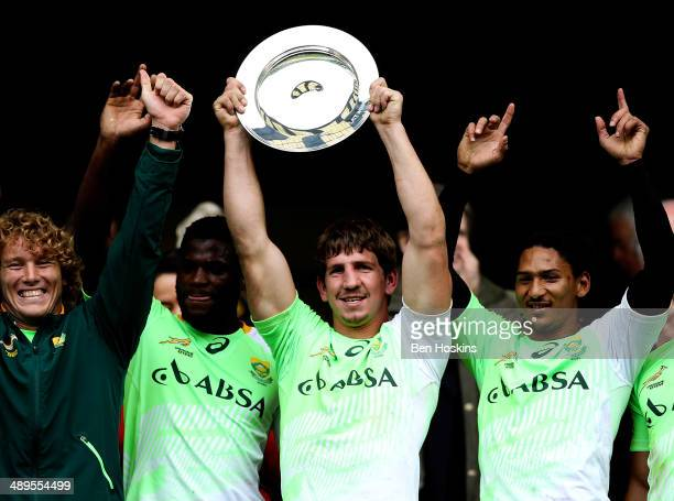 Kwagga Smith of South Africa lifts the trophy after winning the plate competition during The Marriott London Sevens Day 2 at Twickenham Stadium on...