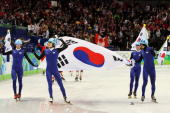 Kwak YoonGy Lee HoSuk Lee JungSu and Sung SiBak of South Korea celebrate the silver medal after the Men's 5000m Relay Short Track Speed Skating Final...