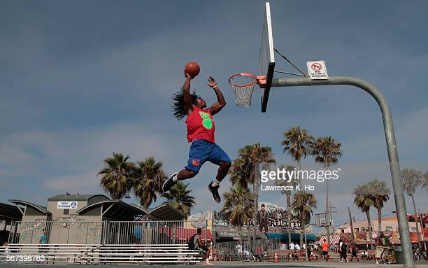 VENICE CA JUN 30 2014 Kwame Alexander demonstrating his famous leap at a basketball court in Venice on Jun 30 2014 Kwame Alexander played college...