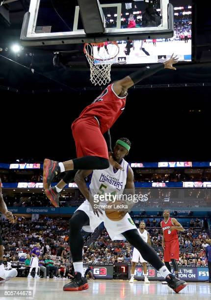 Kwame Brown of the 3 Headed Monsters drives against Rashad McCants of Trilogy during week two of the BIG3 three on three basketball league at...