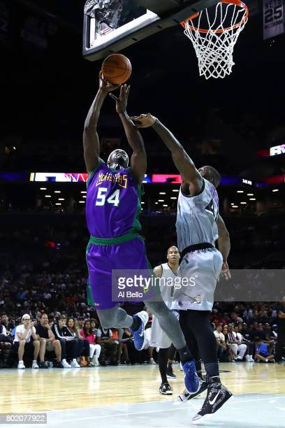 Kwame Brown of the 3 Headed Monsters drives to the basket against Ivan Johnson of the Ghost Ballers during week one of the BIG3 three on three...