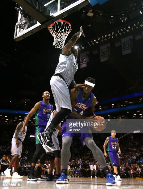 Kwame Brown of the 3 Headed Monsters handles the ball against Ivan Johnson of the Ghost Ballers during week one of the BIG3 three on three basketball...