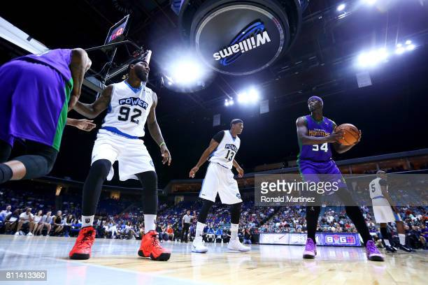 Kwame Brown of the 3 Headed Monsters handles the ball while being guarded by Jerome Williams of Power during week three of the BIG3 three on three...