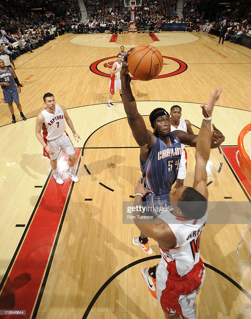 <a gi-track='captionPersonalityLinkClicked' href=/galleries/search?phrase=Kwame+Brown&family=editorial&specificpeople=201536 ng-click='$event.stopPropagation()'>Kwame Brown</a> #54 of the Charlotte Bobcats shoots against DeMar DeRozan #10 of the Toronto Raptors during the game on March 13, 2011 at the Air Canada Centre in Toronto, Ontario, Canada.