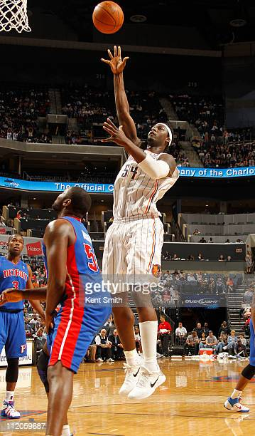 Kwame Brown of the Charlotte Bobcats shoots over Jason Maxiell of the Detroit Pistons on April 10 2011 at Time Warner Cable Arena on the practice...