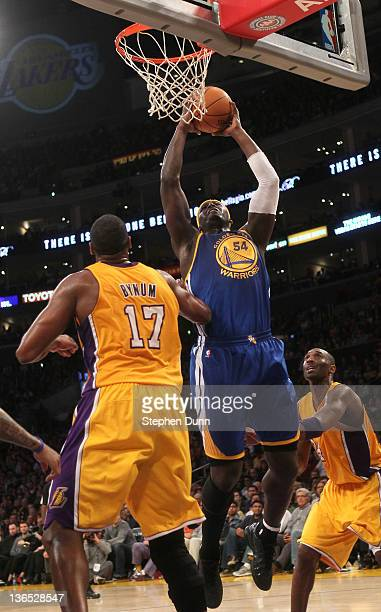Kwame Brown of the Golden State Warriors shoots over Andrew Bynum of the Los Angeles Lakers at Staples Center on January 6 2012 in Los Angeles...