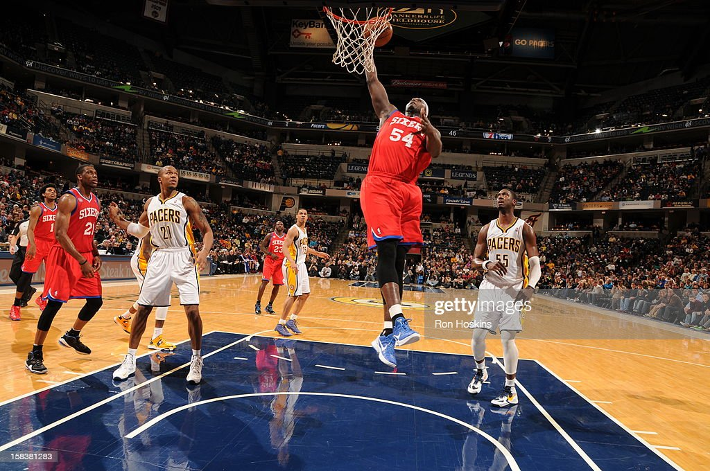 <a gi-track='captionPersonalityLinkClicked' href=/galleries/search?phrase=Kwame+Brown&family=editorial&specificpeople=201536 ng-click='$event.stopPropagation()'>Kwame Brown</a> #54 of the Philadelphia 76ers rises for a dunk against the Indiana Pacers on December 14, 2012 at Bankers Life Fieldhouse in Indianapolis, Indiana.