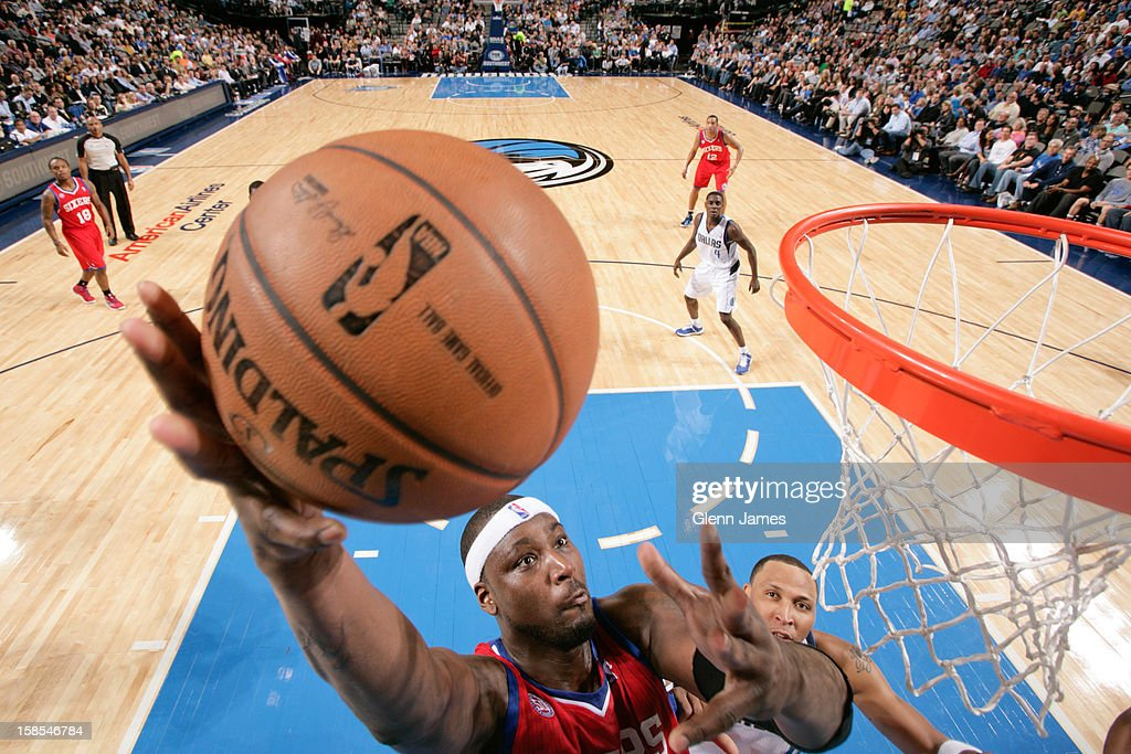 <a gi-track='captionPersonalityLinkClicked' href=/galleries/search?phrase=Kwame+Brown&family=editorial&specificpeople=201536 ng-click='$event.stopPropagation()'>Kwame Brown</a> #54 of the Philadelphia 76ers shoots a layup ahead of <a gi-track='captionPersonalityLinkClicked' href=/galleries/search?phrase=Shawn+Marion&family=editorial&specificpeople=201566 ng-click='$event.stopPropagation()'>Shawn Marion</a> #0 of the Dallas Mavericks on December 18, 2012 at the American Airlines Center in Dallas, Texas.