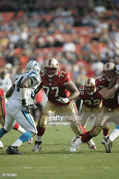 Kwame Harris and Brock Gutierrez of the San Francisco 49ers defend against the Carolina Panthers at Monster Park on November 14 2004 in San Francisco...