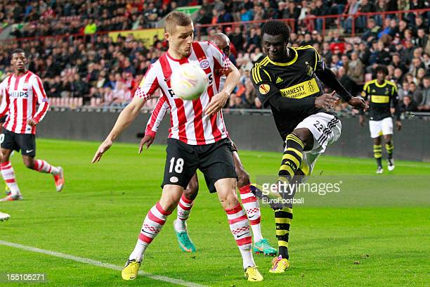 Kwame Karikari of AIK is challenged by Timothy Derijck of PSV Eindhoven during the UEFA Europa League group stage match between PSV Eindhoven and AIK...