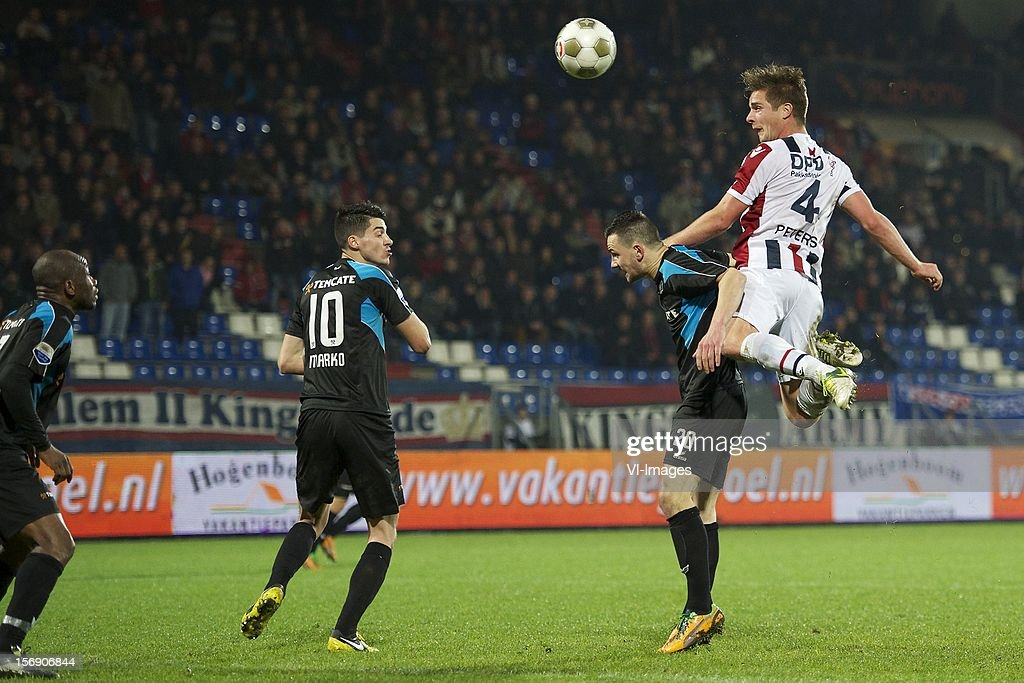 Kwame Quansah of Heracles Almelo, Marko Vejinovic of Heracles Almelo, Thomas Bruns of Heracles Almelo, Jordens Peters of Willem II during the Dutch Eredivisie match between Willem II and Heracles Almelo at the Koning Willem II Stadium on November 24, 2012 in Tilburg, The Netherlands.
