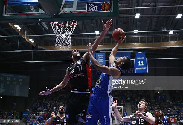 Kwame Vaughn of Frankfurt is challenged by Thomas Scrubb of Giessen during the easyCredit BBL match between Fraport Skyliners and Giessen 46ers at...