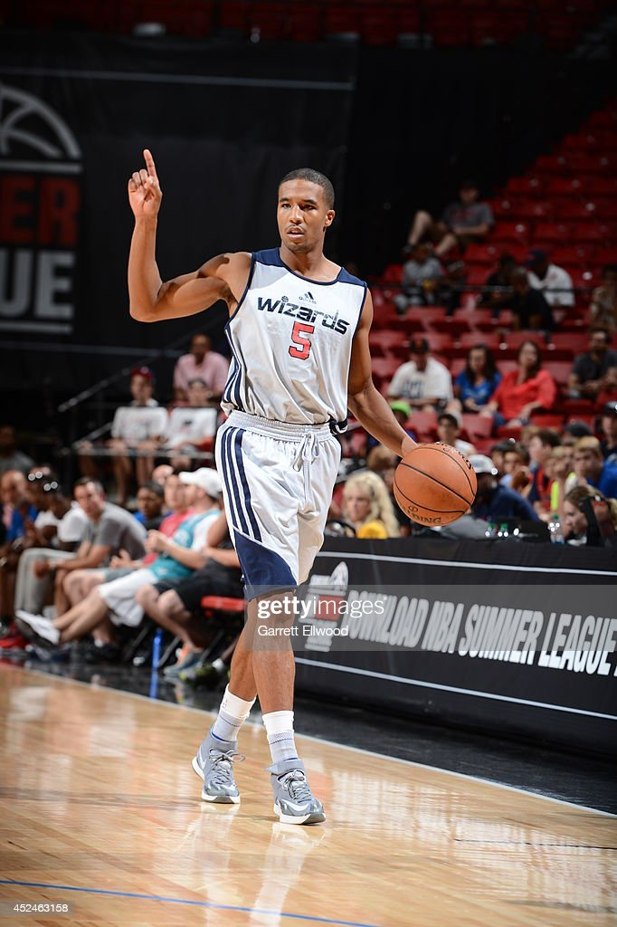 Kwame Vaughn #5 of the Washington Wizards moves the ball up-court against the San Antonio Spurs at the Samsung NBA Summer League 2014 on July 19, 2014 at the Thomas and Mack Center in Las Vegas, Nevada.