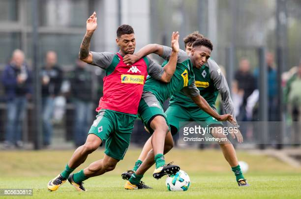 Kwame Yeboah and Reece Oxford battle for the ball during a training session of Borussia Moenchengladbach at BorussiaPark on July 02 2017 in...