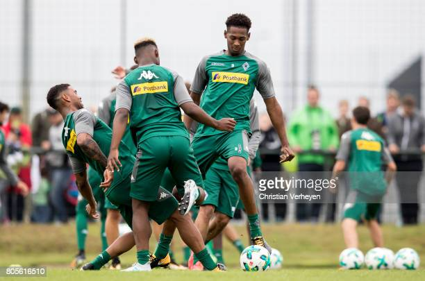 Kwame Yeboah BaMuaka Simakala and Reece Oxford battle for the ball during a training session of Borussia Moenchengladbach at BorussiaPark on July 02...