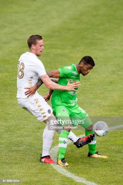 Kwame Yeboah of Borussia Moenchengladbach and Pontus Jansson of Leeds United battle for the ball during a friendly match between Borussia...