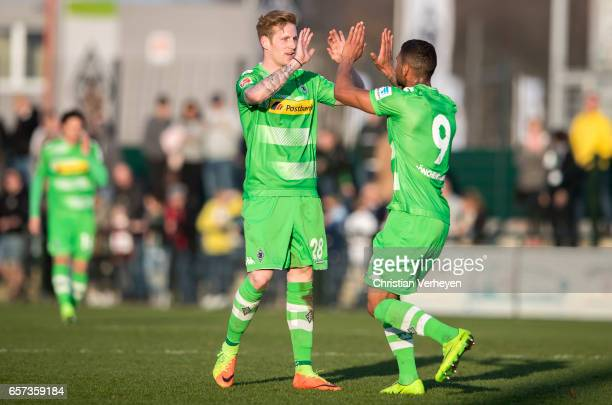 Kwame Yeboah of Borussia Moenchengladbach celebrates with Andre Hahn after he scores his teams third goal during the Friendly Match between Borussia...