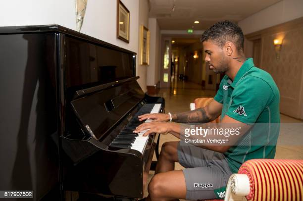 Kwame Yeboah of Borussia Moenchengladbach plays piano after a training session at the Training Camp of Borussia Moenchengladbach on July 18 2017 in...