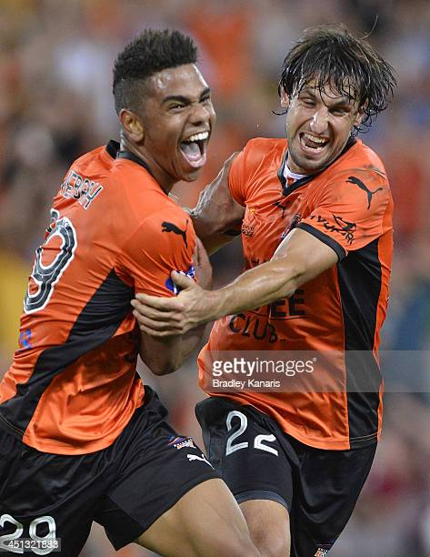 Kwame Yeboah of the Roar celebrates with Thomas Broich after scoring a goal during the round seven ALeague match between the Brisbane Roar and the...