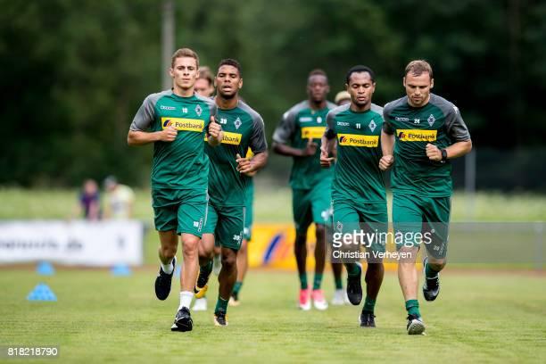 Kwame Yeboah Thorgan Hazard Raffael and Tony Jantschke run during a training session at the Training Camp of Borussia Moenchengladbach on July 18...