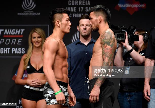 Kwan Ho Kwak of South Korea and Russell Doane of the United States face off during the UFC Fight Night weighin at the Marina Bay Sands on June 16...