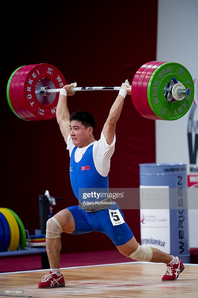 Kwang Song Kim from North Korea lifts in Clean & Jerk competition, men's 77 kg Group A, during the weightlifting IWF World Championships Wroclaw 2013 at Centennial Hall in Wroclaw on October 24, 2013
