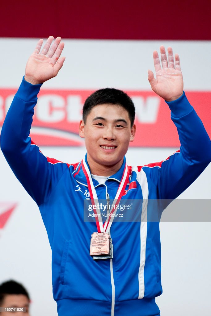 Kwang Song Kim from North Korea poses with medals from the competition fo the men's 77 kg Group A during the weightlifting IWF World Championships Wroclaw 2013 at Centennial Hall in Wroclaw on October 24, 2013