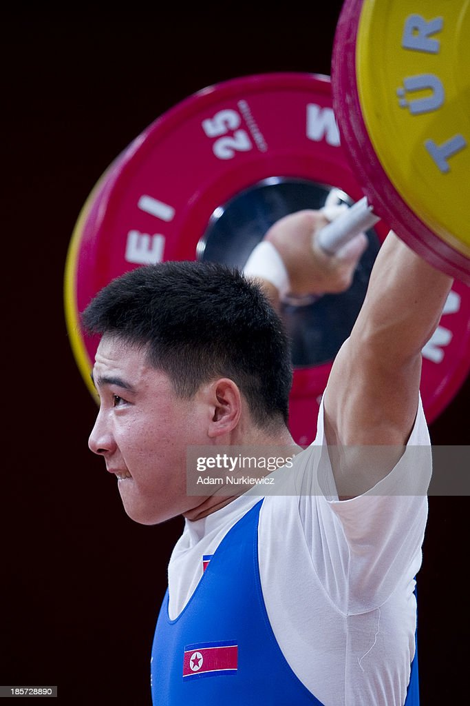 Kwang Song Kim of North Korea lifts in the Snatch competition, men's 77 kg Group A, during the weightlifting IWF World Championships Wroclaw 2013 at Centennial Hall in Wroclaw on October 24, 2013