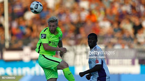 Kwasi Okyere Wriedt of Osnabrueck challenges Patrick Funk of Wiesbaden during the third league match between VfL Osnabrueck and SV Wehen Wiesbaden at...