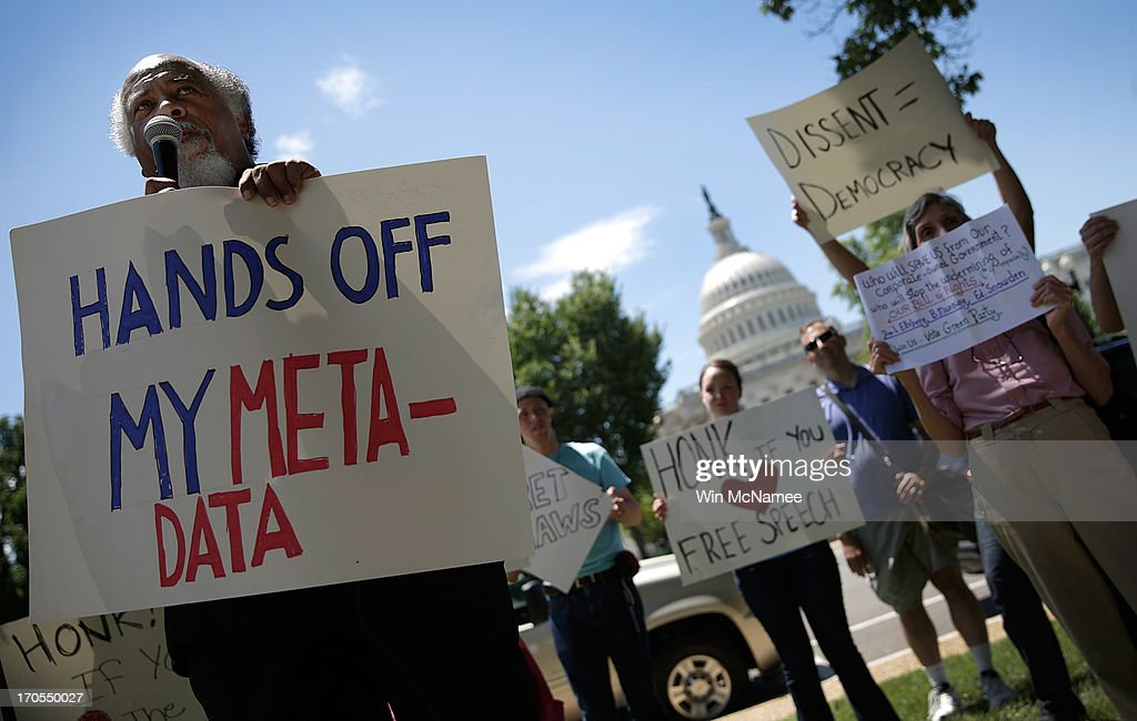 Kwazi Nkrumah speaks while joining protesters rallying outside the US Capitol against the NSA's recently detailed surveillance programs June 13 2013...