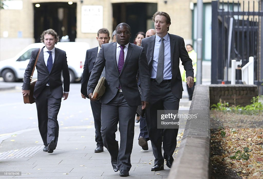 <a gi-track='captionPersonalityLinkClicked' href=/galleries/search?phrase=Kweku+Adoboli&family=editorial&specificpeople=8256036 ng-click='$event.stopPropagation()'>Kweku Adoboli</a>, a former trader at UBS AG, center, arrives at Southwark Crown Court in London, U.K., on Friday, Sept. 14, 2012. Adoboli is charged with falsifying records on exchange-traded fund transactions and other documents needed for accounting purposes as early as October 2008, according to his indictment. Photographer: Chris Ratcliffe/Bloomberg via Getty Images