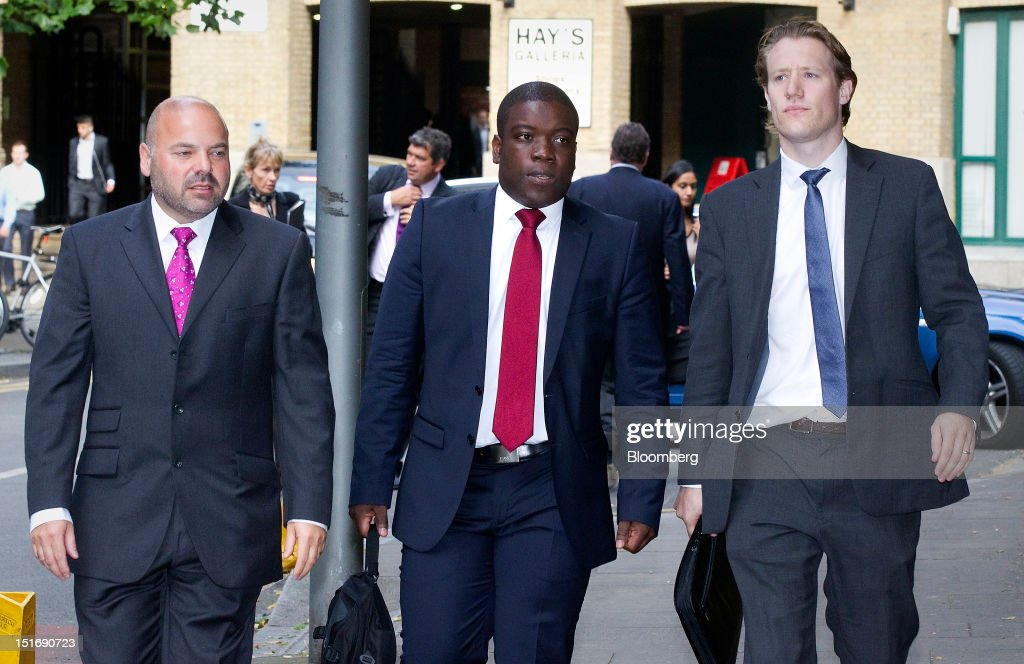 <a gi-track='captionPersonalityLinkClicked' href=/galleries/search?phrase=Kweku+Adoboli&family=editorial&specificpeople=8256036 ng-click='$event.stopPropagation()'>Kweku Adoboli</a>, a former UBS trader, center, arrives for the start of his trial at Southwark Crown Court in London, U.K., on Monday, Sept. 10, 2012. Adoboli, accused of unauthorized trades that cost UBS AG $2.3 billion, will go on trial this week charged with fraud and false accounting in one of the highest-profile banking cases ever heard in London. Photographer: Simon Dawson/Bloomberg via Getty Images