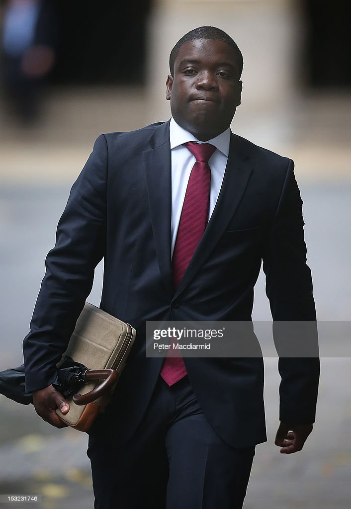 <a gi-track='captionPersonalityLinkClicked' href=/galleries/search?phrase=Kweku+Adoboli&family=editorial&specificpeople=8256036 ng-click='$event.stopPropagation()'>Kweku Adoboli</a> arrives at Southwark Crown Court on October 2, 2012 in London. Mr Adoboli denies two charges of fraud and two of false accounting dating back to 2008. It was during this time as a trader at Swiss Bank UBS that he lost the bank 1.4 billion GBP in illicit trades according to the prosecution.