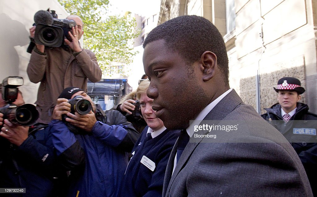 <a gi-track='captionPersonalityLinkClicked' href=/galleries/search?phrase=Kweku+Adoboli&family=editorial&specificpeople=8256036 ng-click='$event.stopPropagation()'>Kweku Adoboli</a>, the former UBS trader, center right, is escorted to a prison van as he leaves the City of London magistrates court in London, U.K., on Thursday, Oct. 20, 2011. Adoboli, the trader accused of costing UBS AG $2.3 billion by making unauthorized trades, falsified records on exchange-traded-fund transactions, prosecutors said. Photographer: Simon Dawson/Bloomberg via Getty Images