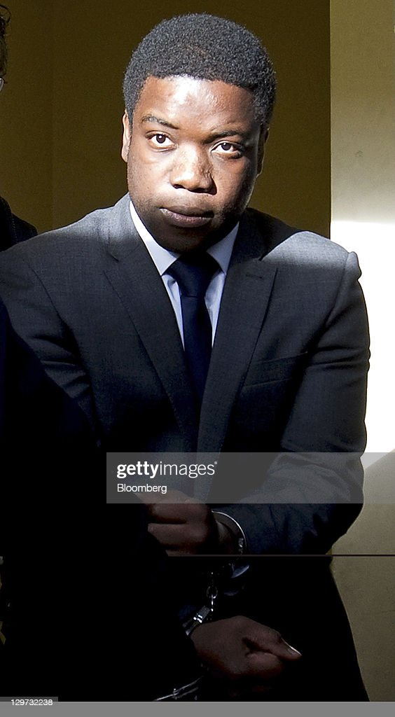 <a gi-track='captionPersonalityLinkClicked' href=/galleries/search?phrase=Kweku+Adoboli&family=editorial&specificpeople=8256036 ng-click='$event.stopPropagation()'>Kweku Adoboli</a>, the former UBS trader, is escorted to a prison van as he leaves the City of London magistrates court in London, U.K., on Thursday, Oct. 20, 2011. Adoboli, the trader accused of costing UBS AG $2.3 billion by making unauthorized trades, falsified records on exchange-traded-fund transactions, prosecutors said. Photographer: Simon Dawson/Bloomberg via Getty Images