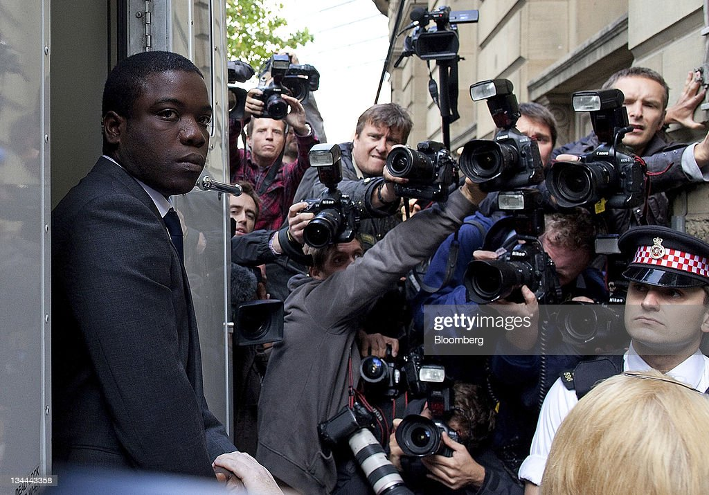 <a gi-track='captionPersonalityLinkClicked' href=/galleries/search?phrase=Kweku+Adoboli&family=editorial&specificpeople=8256036 ng-click='$event.stopPropagation()'>Kweku Adoboli</a>, the UBS trader, left, is escorted from a prison van as he arrives at the City of London magistrates court in London, U.K., on Thursday, Sept. 22, 2011. Adoboli, the UBS AG trader accused of fraud and false accounting that led to a $2.3 billion loss for Switzerland's largest bank, may ask a court to be released on bail while he awaits trial. Photographer: Simon Dawson/Bloomberg via Getty Images