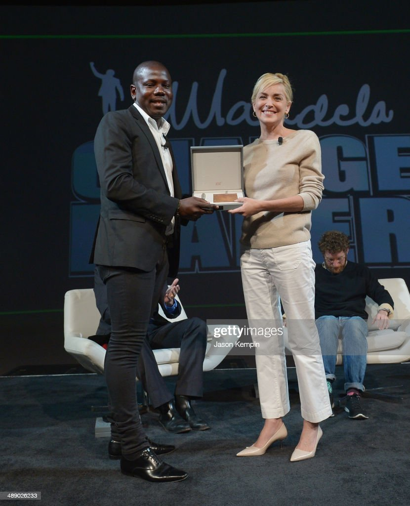 Kweku Mandela and Sharon Stone attend the 2014 PTTOW! Summit - Day 3 at Terrenea Resort on May 9, 2014 in Rancho Palos Verdes, California.