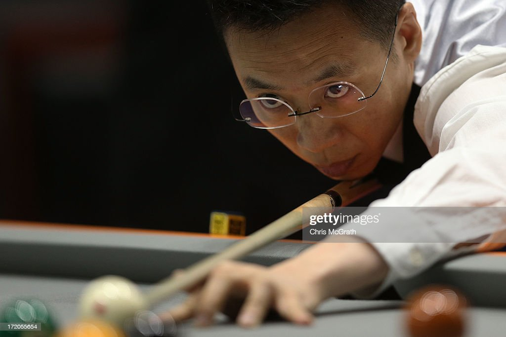 Kwok Chi Ho of Hong Kong, China plays a shot against Nasution Irsal Afrinneza of Indonesia during their Billiards, Men's 9 Ball Single Quarterfinals match at Songdo Convensia on day three of the 4th Asian Indoor & Martial Arts Games on July 1, 2013 in Incheon, South Korea.