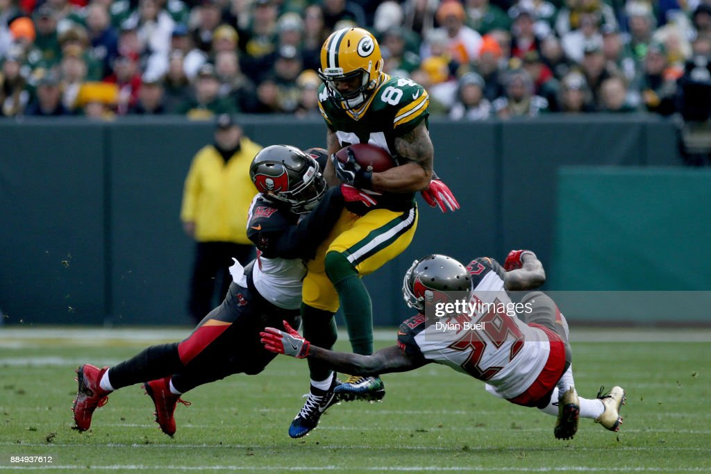 Kwon Alexander #58 and Ryan Smith #29 of the Tampa Bay Buccaneers combine for a tackle against Lance Kendricks #84 of the Green Bay Packers in the first quarter at Lambeau Field on December 3, 2017 in Green Bay, Wisconsin.
