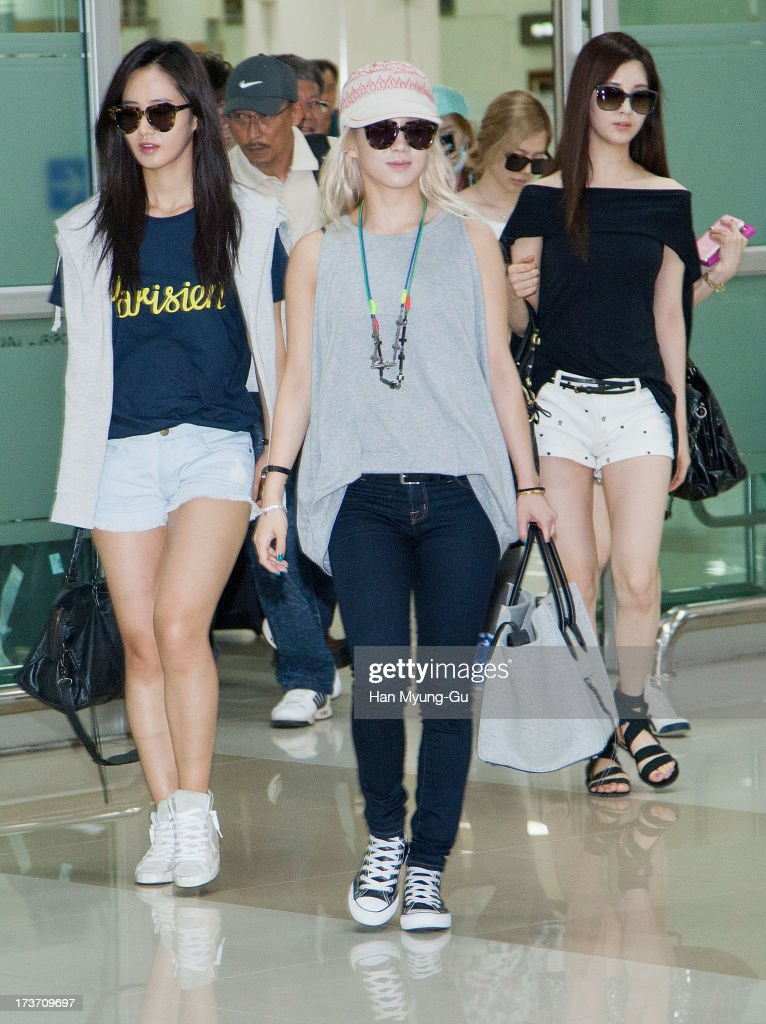 Kwon Yu-Ri (Yu-Ri) and Hyoyeon of South Korean girl group Girls' Generation are seen upon arrival at Gimpo International Airport on July 17, 2013 in Seoul, South Korea.