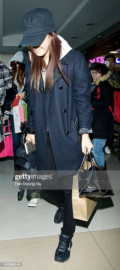 Kwon Yu-Ri (Yuri) of South Korean girl group Girls' Generation is seen at Gimpo International Airport on February 11, 2013 in Seoul, South Korea.