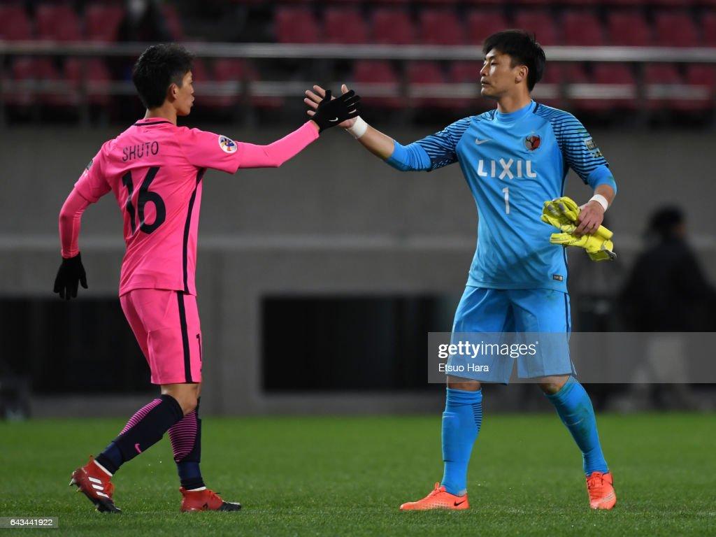 Kwoun Sun Tae(R) and Shuto Yamamoto of Kashima Antlers celebrate their 2-0 win after the AFC Champions League Group E match between Kashima Antlers and Ulsan Hyndai at Kashima Soccer Stadium on February 21, 2017 in Kashima, Ibaraki, Japan.
