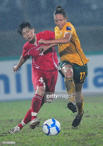 Kyah Pam Simon of Australia competes with Yun Song Mi of DPR Korea during the AFC Women's Asian Cup Final between Australia and DPR Korea at Chengdu...