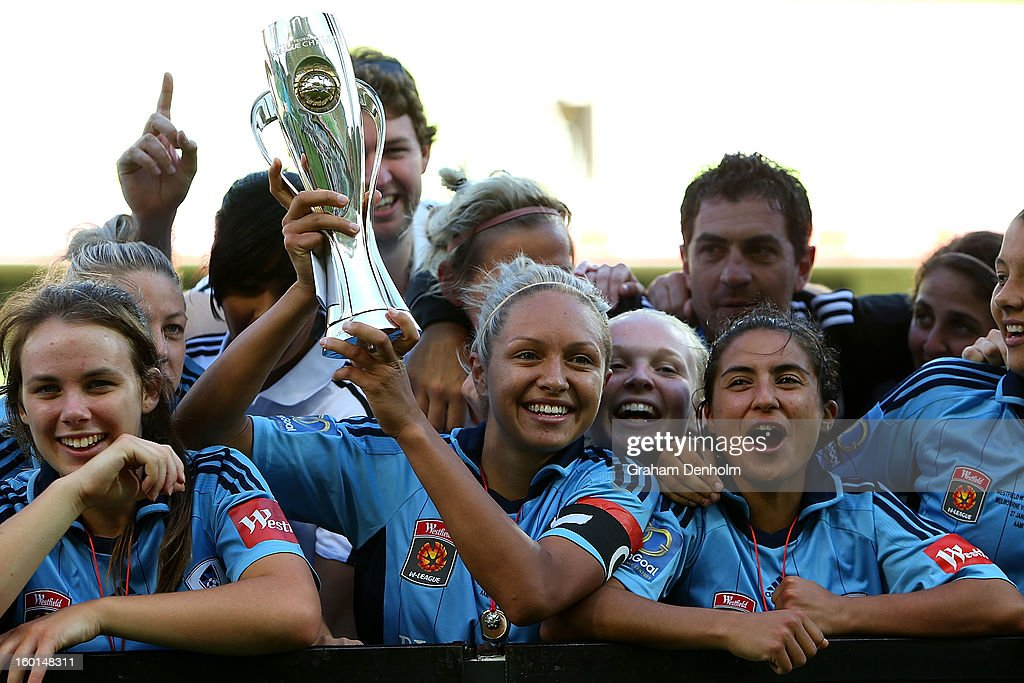 Kyah Simon Captain of Sydney FC (C) celebrates with the trophy after winning the W-League Grand Final between the Melbourne Victory and Sydney FC at AAMI Park on January 27, 2013 in Melbourne, Australia.