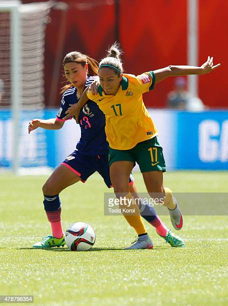 Kyah Simon of Australia and Rumi Utsugi of Japan battle for position during the FIFA Women's World Cup Canada Quarter Final match between Australia...