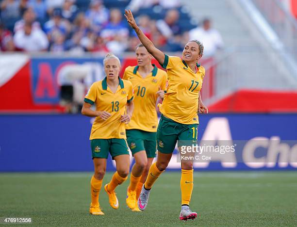 Kyah Simon of Australia celebrates after scoring her second goal past goalkeeper Precious Dede of Nigeria during the FIFA Women's World Cup Canada...