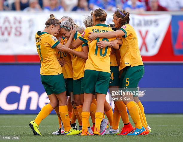 Kyah Simon of Australia celebrates her second goal past goalkeeper Precious Dede of Nigeria with teammates during the FIFA Women's World Cup Canada...