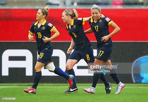 Kyah Simon of Australia celebrates with team mates Katrina Gorry and Elise KellondKnight as she scores their first goal during the FIFA Women's World...